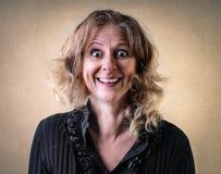 Vrouw met een gelukkige uitdrukking stock foto