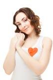 Vrouw met een gespeld hart Stock Foto's