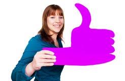 Vrouw met een grote roze duim stock foto