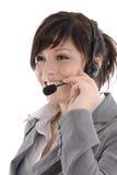 Vrouw met een hoofdtelefoon Stock Fotografie