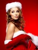 Vrouw met een Kerstmisgift royalty-vrije stock foto