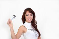 Vrouw met een moersleutel Stock Afbeelding