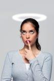 Vrouw met een schuldig geweten Stock Foto