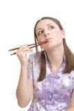 Vrouw met eetstokjes Stock Foto's