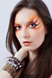 Vrouw met fantasie rode make-up Stock Afbeeldingen