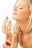 Vrouw met fles parfum Stock Foto