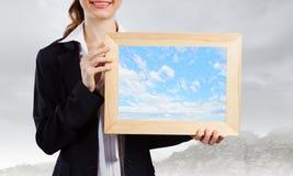 Vrouw met frame Royalty-vrije Stock Afbeeldingen