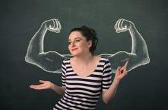 Vrouw met geschetste sterke en gespierde wapens Stock Foto's
