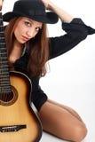 Vrouw met gitaar. Stock Foto's