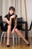 Vrouw met glas rode wijn Royalty-vrije Stock Afbeelding