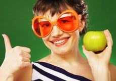 Vrouw met groene appel royalty-vrije stock foto