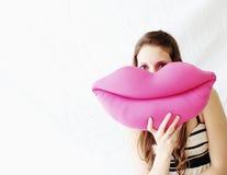 Vrouw met haar mondstuk speelgoed Stock Afbeeldingen