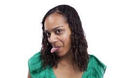 Vrouw met haar uit tounge Stock Foto