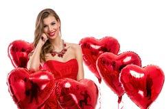 vrouw met hart-vormige ballons Royalty-vrije Stock Foto