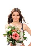 Vrouw met het mooie boeket van bloemenrozen Royalty-vrije Stock Afbeeldingen