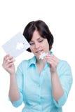 Vrouw met het ontbrekende stuk van het raadsel Stock Fotografie