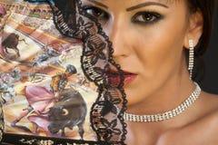 Vrouw met het vouwen van ventilator Royalty-vrije Stock Afbeeldingen