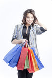 Vrouw met het winkelen zakken Stock Foto
