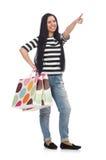 Vrouw met het winkelen zakken op wit Stock Fotografie