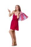 Vrouw met het winkelen zakken op wit Stock Foto