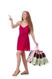 Vrouw met het winkelen zakken op wit wordt geïsoleerd dat Stock Foto