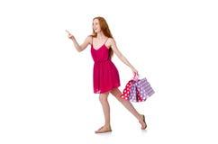 Vrouw met het winkelen zakken op wit wordt geïsoleerd dat Stock Afbeelding