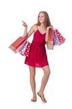 Vrouw met het winkelen zakken op wit wordt geïsoleerd dat Stock Fotografie