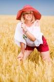 Vrouw met hoed Stock Afbeeldingen