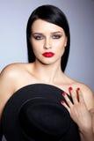 Vrouw met hoed Stock Foto