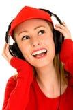 Vrouw met Hoofdtelefoons Stock Afbeeldingen