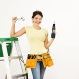 Vrouw met hulpmiddelen. Stock Afbeeldingen