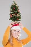 Vrouw met Kerstmisboom Stock Foto's