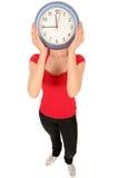 Vrouw met klok die gezicht behandelt Stock Afbeelding