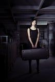 Vrouw met koffer Royalty-vrije Stock Afbeelding