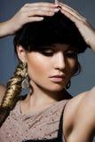 Vrouw met kunstgezicht Stock Foto