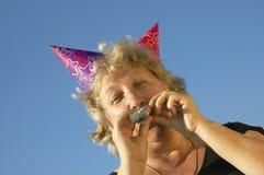 Vrouw met lawaai-maker royalty-vrije stock afbeeldingen