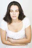 Vrouw met maagproblemen stock foto