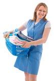 Vrouw met mand van wasserij stock afbeeldingen