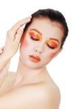 Vrouw met mooi kunst oranje abstract merk-u Stock Afbeelding