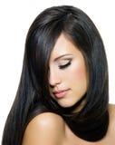 Vrouw met mooie lange bruine haren Royalty-vrije Stock Foto