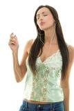 Vrouw met MP3 speler Stock Foto