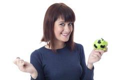 Vrouw met muntstuk en spaarvarken Royalty-vrije Stock Fotografie