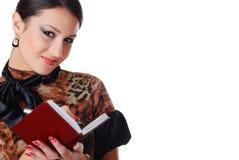Vrouw met notitieboekje Royalty-vrije Stock Afbeelding