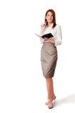 Vrouw met notitieboekje en pen Stock Foto's