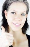 Vrouw met omhoog duim Royalty-vrije Stock Afbeeldingen