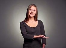 Vrouw met open palm Stock Fotografie