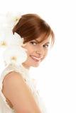 Vrouw met orchideeën Royalty-vrije Stock Fotografie