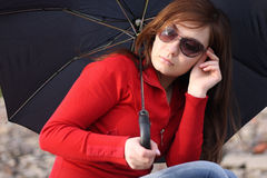 Vrouw met paraplu Stock Afbeelding