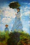 Vrouw met parasol-Mevrouw Monet stock afbeeldingen