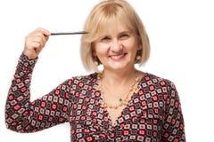 Vrouw met pen Royalty-vrije Stock Foto